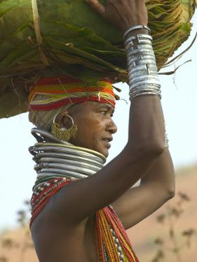 Portrait of a Bondo Woman Carrying a Load on Her Head Walking to Market, Early Morning by Keren Su