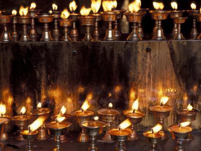 Prayer Flames, Jokhong Temple, Lhasa, Tibet by Keren Su