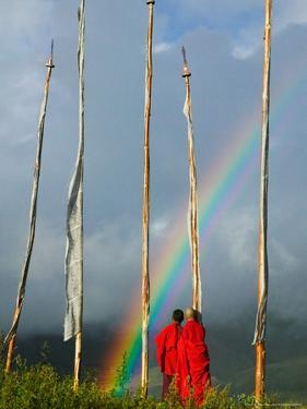 Rainbow and Monks with Praying Flags, Phobjikha Valley, Gangtey Village, Bhutan by Keren Su