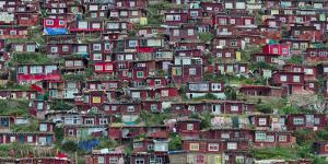 Red log cabins, Seda Larung Wuming, Garze, Sichuan Province, China by Keren Su
