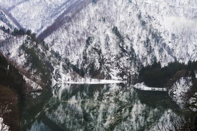 Reflection of mountain covered with snow in the lake, Japan by Keren Su