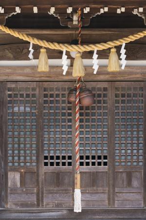 Straw rope decoration in a temple, Gujo Hachiman, Japan by Keren Su