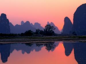 Sunset on the Karst Hills and Li River, China by Keren Su