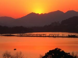 Sunset Over West Lake in Hangzhou, Hangzhou, Zhejiang, China by Keren Su