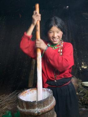 Tibetan Girl Making Butter Tea Inside the Yurt, Dingqing, Tibet, China by Keren Su