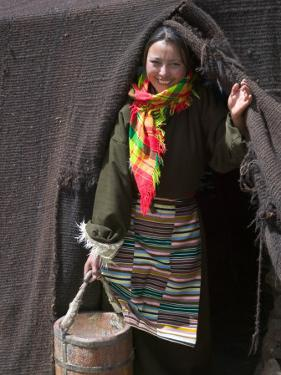 Tibetan Woman Carrying a Bucket to the Tent, East Himalayas, Tibet, China by Keren Su