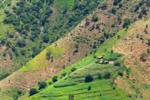 Village house and farmland on mountain slope, Simien Mountain, Ethiopia by Keren Su