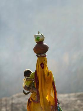 Village Woman Carrying Baby and Load on the Head, Udaipur, Rajasthan, India by Keren Su