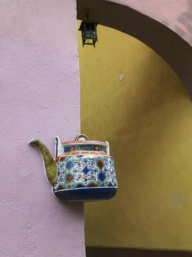 Wall Decorated with Teapot and Cobbled Street in the Old Town, Vilnius, Lithunia by Keren Su
