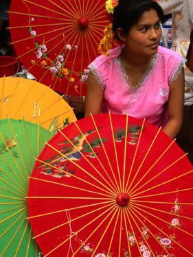 Water Dai Woman with Colourful Umbrellas, Xishuangbanna, China by Keren Su