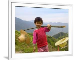 Young Girl Carrying Shoulder Pole with Straw Hats, China by Keren Su