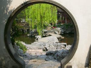 Zig Zag Stone Bridge and Willow Trees Through Moon Gate, Chinese garden, China by Keren Su