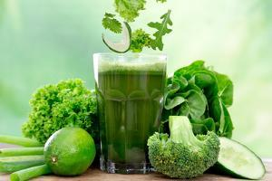 Healthy Green Vegetable Juice on Wooden Table by Kesu01
