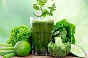 Healthy Green Vegetable Juice on Wooden Table by Kesu01