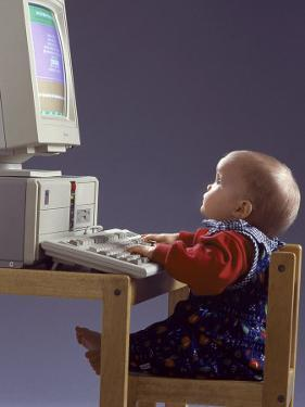 Baby Sitting at Desk Using Computer by Kevin Leigh