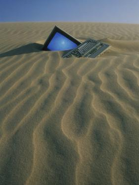 Computer Buried in Sand by Kevin Leigh