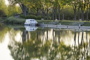 France, Burgundy, Nievre, Cercy La Tour. Canal Boat at the Dock by Kevin Oke
