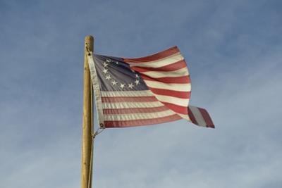 USA, Arizona. Apache Junction, Betsy Ross US flag, Apacheland Movie Ranch by Kevin Oke