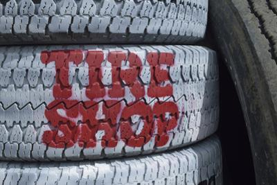 USA, Nevada. Beatty, tire shop sign painted on old tires by Kevin Oke