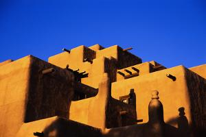 Pueblo and Blue Sky by Kevin Schafer