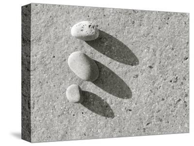 Three Pebbles on Granite