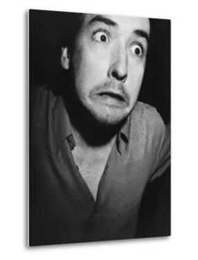 """Actor John Cusack Making a Frightful Face at Movie Premiere, """"When Harry Met Sally"""" by Kevin Winter"""