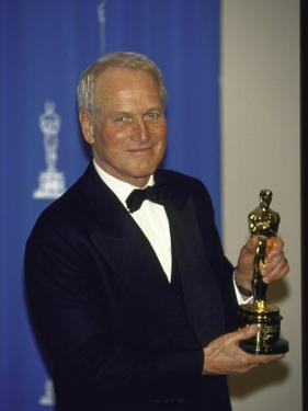 Actor Paul Newman Holding His Oscar in Press Room at the Academy Awards by Kevin Winter