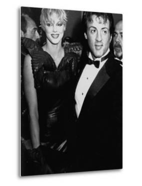 """Actors Sylvester Stallone and Brigitte Nielsen at Film Premiere of His """"Rocky IV"""" by Kevin Winter"""