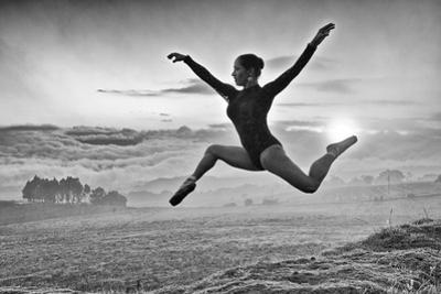 A Ballerina Dances Beneath a Cloud-Filled Sky by Kike Calvo