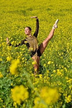 A Ballerina Dances Wearing Pre-Columbian Gold Jewelry Replicas in a Field of Wildflowers by Kike Calvo