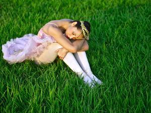 A Ballerina Rests in the Grass Near the Panama Canal by Kike Calvo