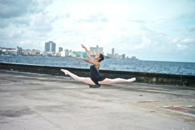 A Classic Ballerina from the Cuba National Ballet at the Malecon by Kike Calvo