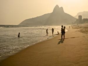 A Couple Embrace on Ipanema Beach as the Sun Sets by Kike Calvo