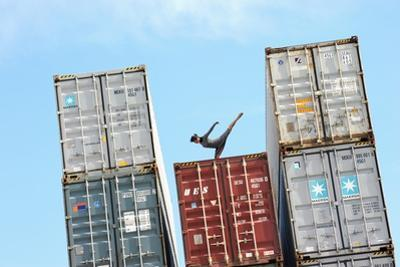 A Dancer of the National Ballet of Panama, Posing on Containers