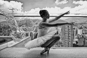 Ballerina Balancing on a Rooftop in Medellin by Kike Calvo