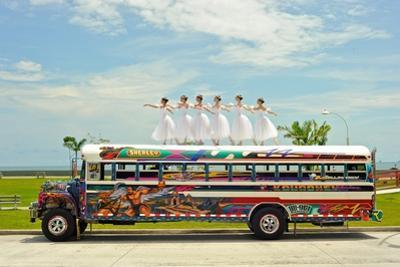 Ballerinas Dance on Top of a Diablo Rojo Bus on La Cinta Costera, Panama's Coastal Highway by Kike Calvo