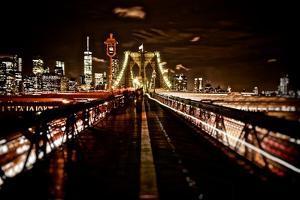 Brooklyn Bridge and the Manhattan Skyline in the Background by Kike Calvo