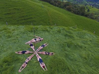 High Angle View of Pole Dancers by Kike Calvo