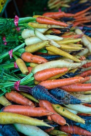 Multicolored Carrots at a Farmers' Market by Kike Calvo