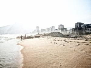 People Walk on Ipanema Beach as the Sun Sets by Kike Calvo