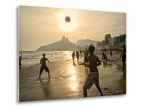 Young Men Play Beach Football on Ipanema Beach as the Sun Sets by Kike Calvo
