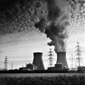 Cooling Towers of a Nuclear Power Plant Creating Dark Clouds Monochrome Film Grain by kikkerdirk