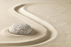 Zen Meditation Stone in Sand. Concept for Purity Harmony and Spirituality. Spa Wellness and Yoga Ba by kikkerdirk