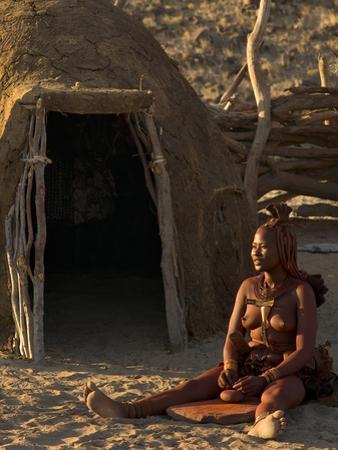 Himba Woman Grinding Rock into Powder, Purros Village, Kaokoland, Namibia by Kim Walker