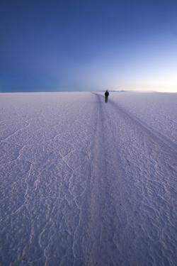 Lone Person in Distance Walks by Kim Walker