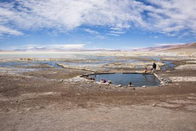 Overview Shot of Tourists Soaking in the Laguna Polques Hot Springs by Kim Walker