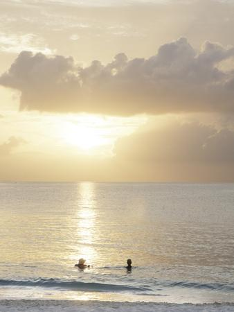 Two Swimmers in Ocean at Sunset, Grace Bay, Providenciales, Turks and Caicos, West Indies
