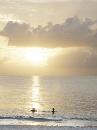 Two Swimmers in Ocean at Sunset, Grace Bay, Providenciales, Turks and Caicos, West Indies by Kim Walker