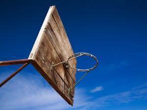 Basketball Net Against Blue Sky by Kimberley Coole
