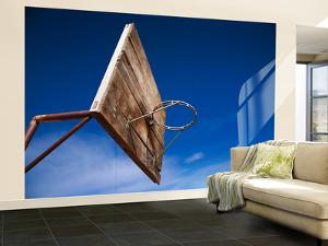 Basketball Net Against Blue Sky by Kimberley Coole